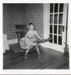 Young Mike Huckabee with Christmas Guitar