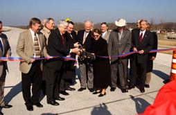 Governor Huckabee cutting the ribbon on renovated interstate